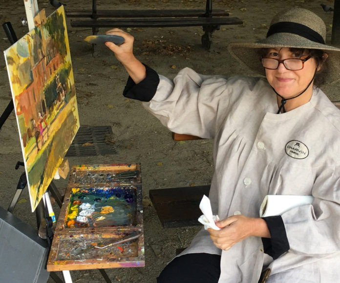 Woman artist painting on an easel